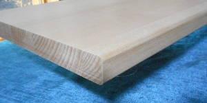Massives Buche-Brett aus Buche-Leimholzplatte mit durchgehenden Lamellen geschnitten, 26mm stark, Kanten an einer Seite oben und unten             mit 6mm Radius abgerundet