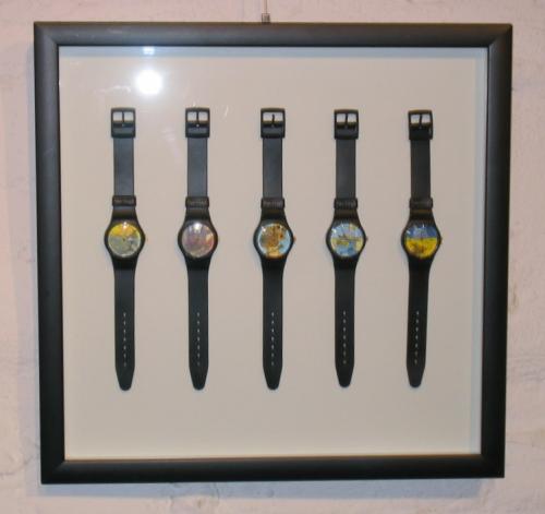 Einrahmung einer Uhrensammlung